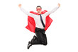 Male superhero jumping out of happiness