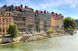 row of buildings on river saone