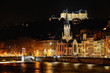 Постер, плакат: saint georges church next to the Saone river at night