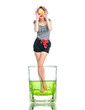 Creative photo of a young woman standing in glass beaker