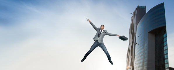 Businessman jumping in joy.