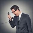 canvas print picture - Mann schreit ins Telefon