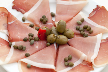 Prosciutto with olives and caper