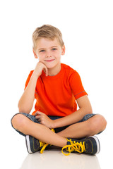 boy sitting on white background