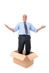 Businessman inside a box