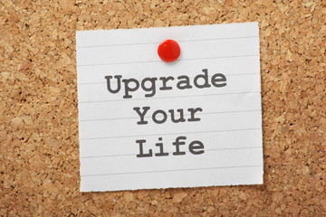 Upgrade Your Life reminder on a cork notice board