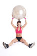 Young fitness woman training with gym ball