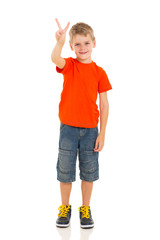 little boy showing victory hand sign
