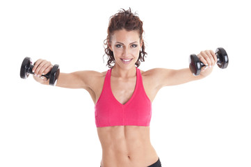 Young fitness woman training with weights