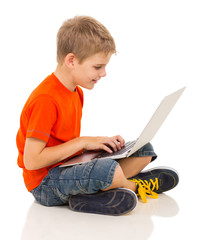cute boy using laptop computer