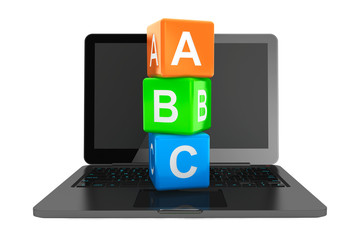 Online Education Concept. Modern Laptop with ABC toy cubes
