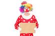 Sad male clown holding a blank carton sign
