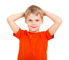 boy with his hands behind his head