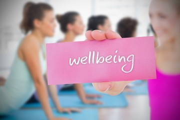 Fit blonde holding card saying wellbeing