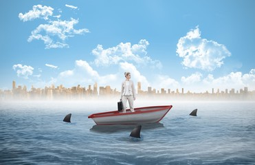 Composite image of serious classy businesswoman in a sailboat