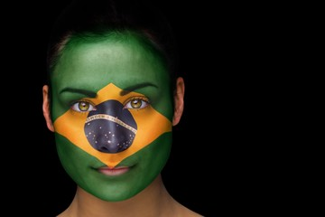 Composite image of brazil football fan in face paint