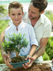 Father educate son to care a plant