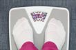 Female feet on funny bathroom scale