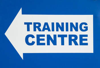 Sign with Arrow Pointing Left Stating TRAINING CENTRE