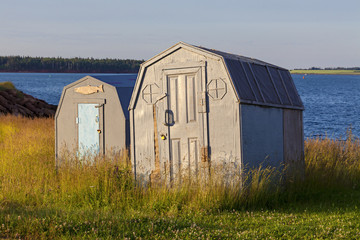 Ice Fishing Shacks on shore for the summer