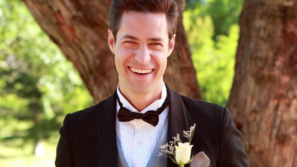 Happy groom laughing and smiling at camera