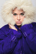 beautiful woman with fur hood.winter.fashion girl in blue coat