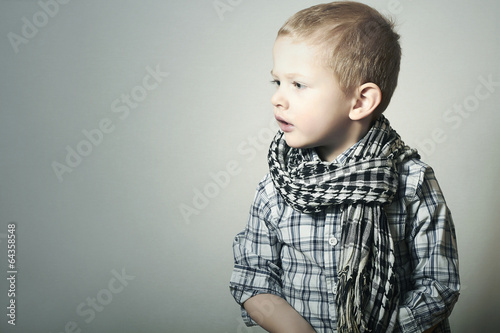 Child. Fashionable Funny little Boy in Scurf. Fashion Children