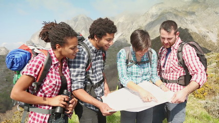 Group of Hikers Looking at Map