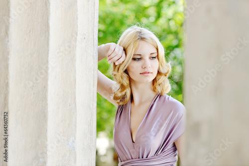 tender girl near the column