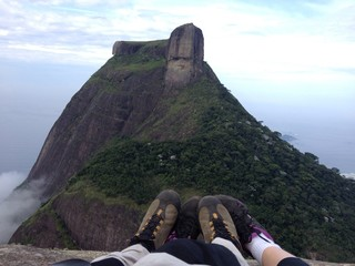Sneackers on peak of mountain in clouds, Rio de Janeiro
