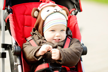 baby boy in red stroller