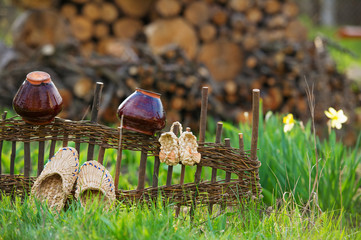 Rustic view with pots and straw shoes