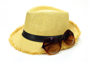 hat and sun glasses isolated on white