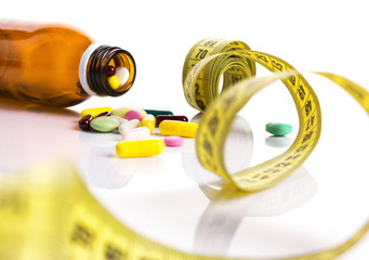 centimeter and pills for dieting concept