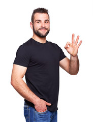 Picture of handsome man showing ok sign on the portrait