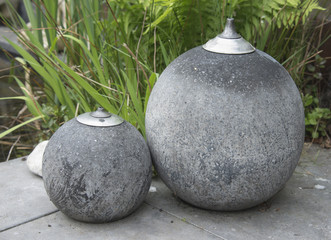 two concrete big oil lamps for outside