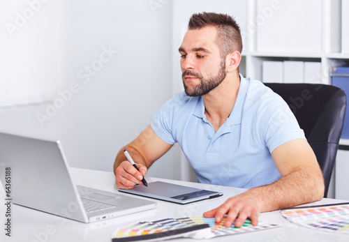 Graphic designer working on digital tablet