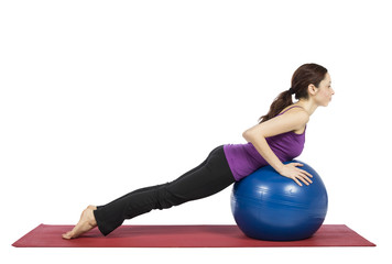 Woman working out on a pilates ball