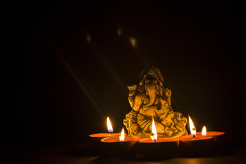 lord ganesha with oil lamp