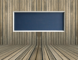 Black blank chalkboard on wood wall for background