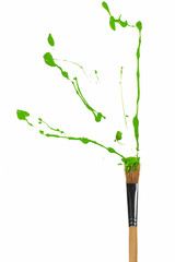 Green paint bursting out of paintbrush