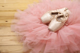 Fototapety pair of ballet shoes pointes on wooden floor