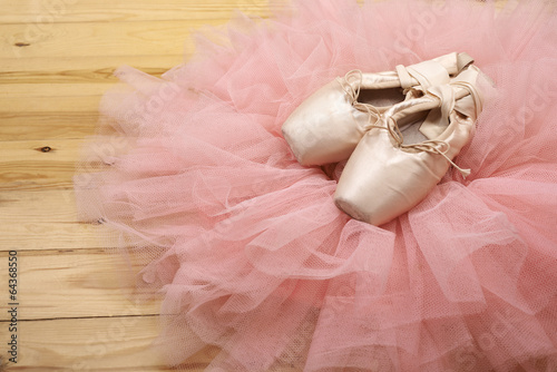 Fotobehang Dance School pair of ballet shoes pointes on wooden floor
