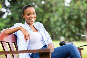 young african woman sitting outdoors