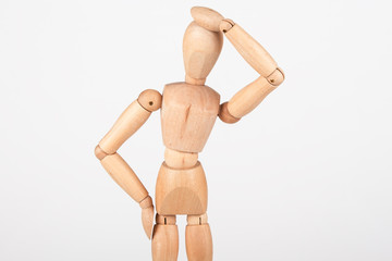 Plain wood mannequin stand upright isolated on white holding hea