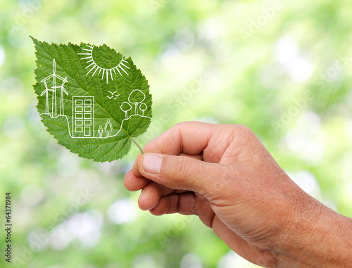 hand holding Green city concept, cut the leaves of plants - 64371984