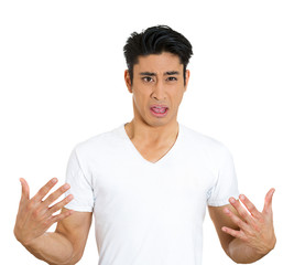Me? Portrait of angry, offended young man on white background