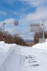 speed limit sign on the snowy road