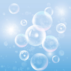 Group of transparent spheres on blue background