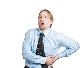 Young business man having severe back pain, kidney stones